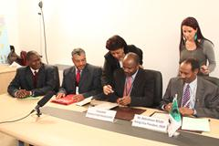 Signing the project grant agreement. Seated, right to left: Mr Abdirahman Beileh, Acting Director, OSAN-2, African Development Bank; Dr Nterenya Sanginga, Director General, IITA; Dr Mohammed El Mourid, Coordinator of ICARDA's North Africa Regional Program; and Dr Dougou Keita, Director Division, OSAN-2